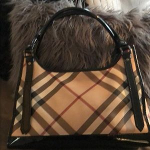 Authentic Burberry Patent Leather trimmed bag.